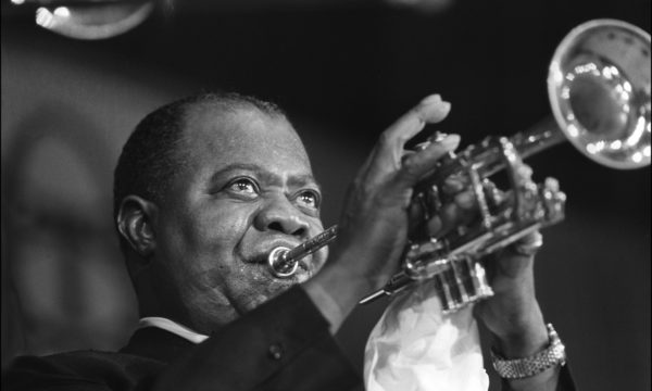 (FILES) Picture shows American jazzman Louis Armstrong during a concert in Paris, 5th June 1965.  N/B  B/W (Photo credit should read /AFP/Getty Images)